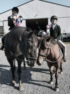 Image of girls with their horse and medals